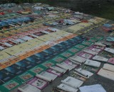 Rows of ruined school textbooks are left to dry after a king tide almost washes them away